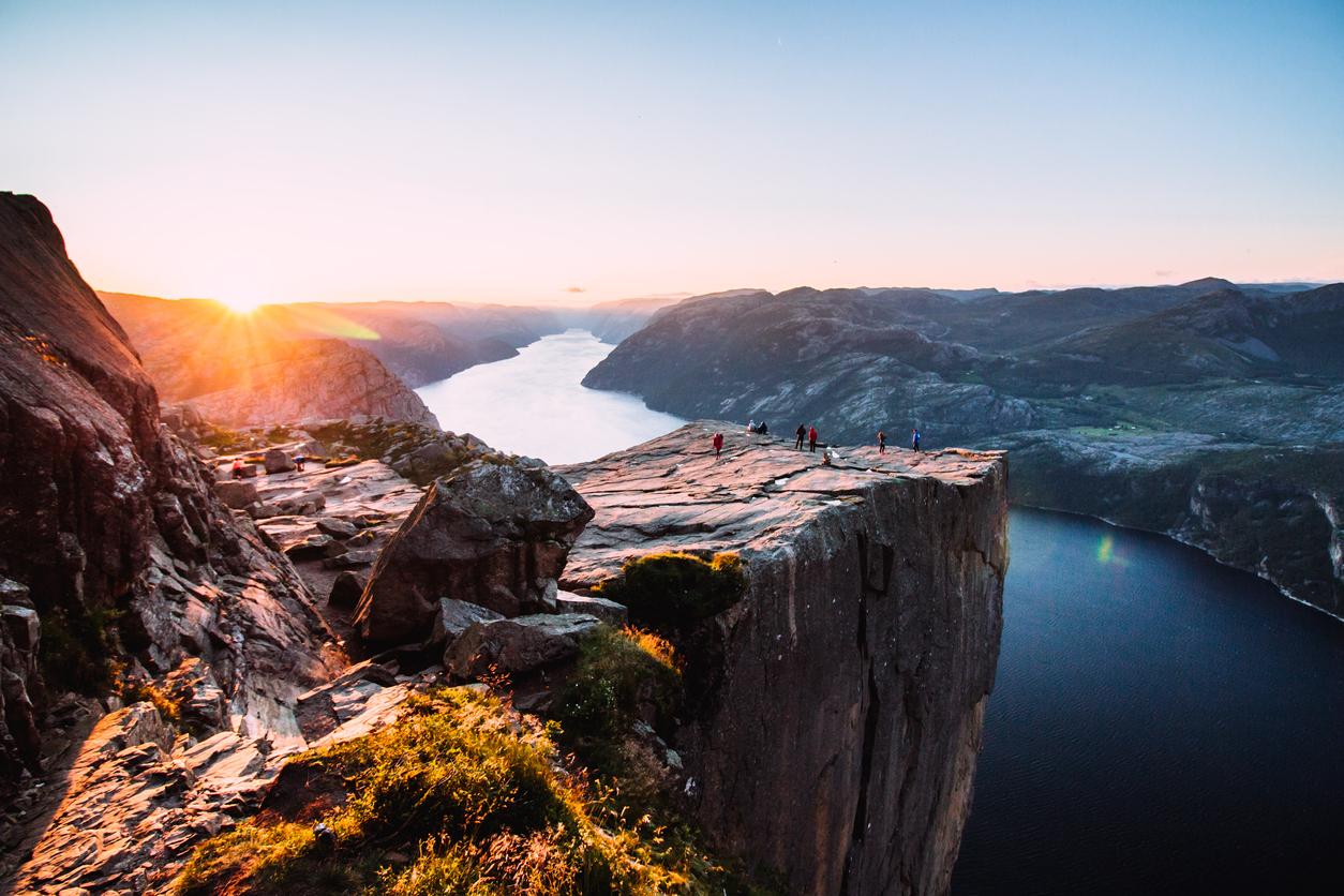 Warm orange sunrise at the Preikestolen in the summer in Norway